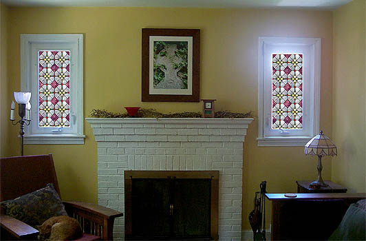 Photo of our living room with pretty stained glass Photoshopped in over the windows on either side of the fireplace.